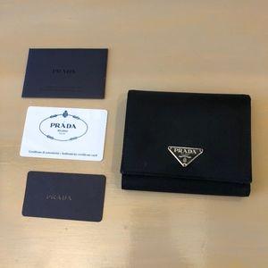 b94557ef1ad6 ... coupon for prada bags prada black saffiano trifold wallet ffe7b 38b41